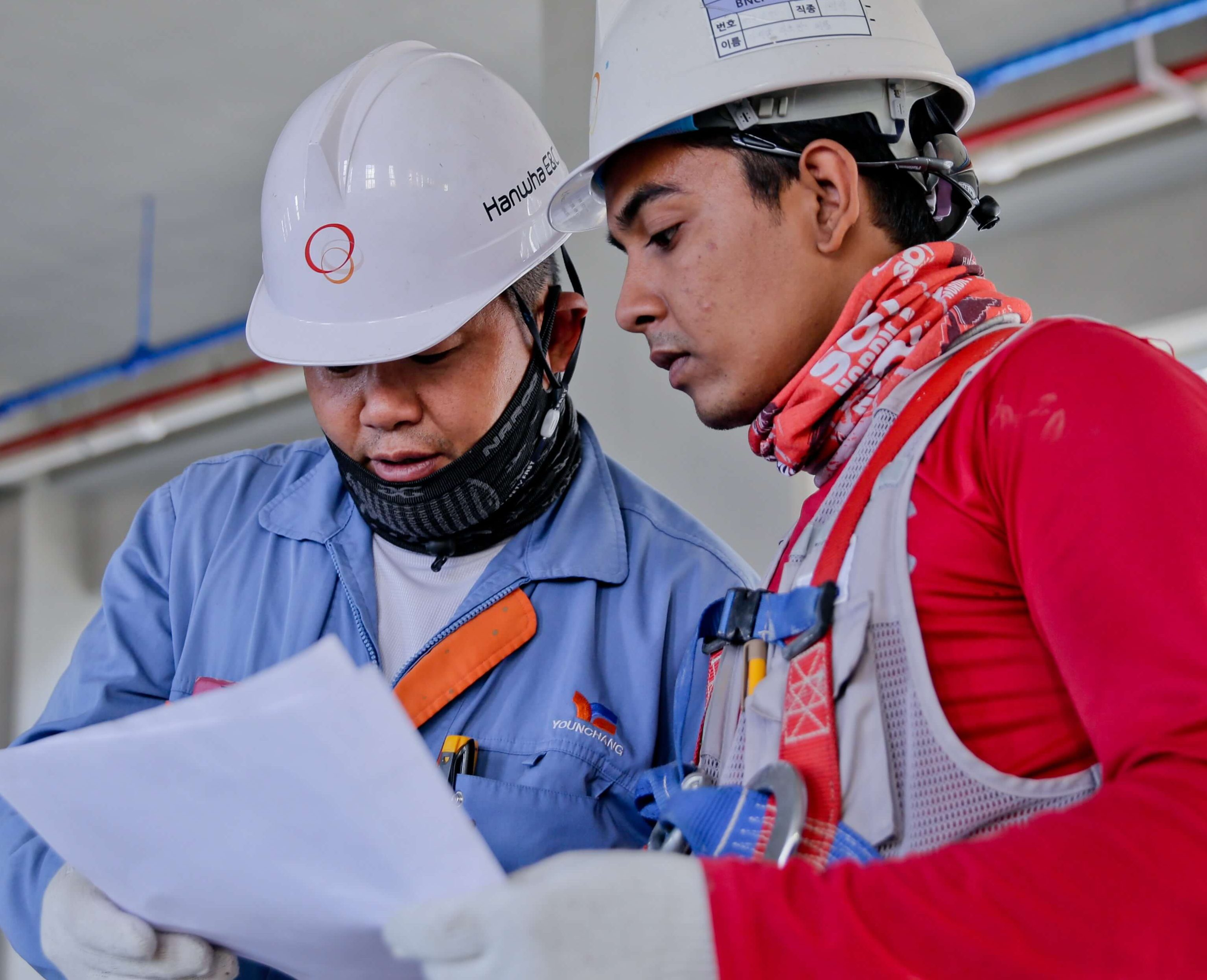 One worker consulting another